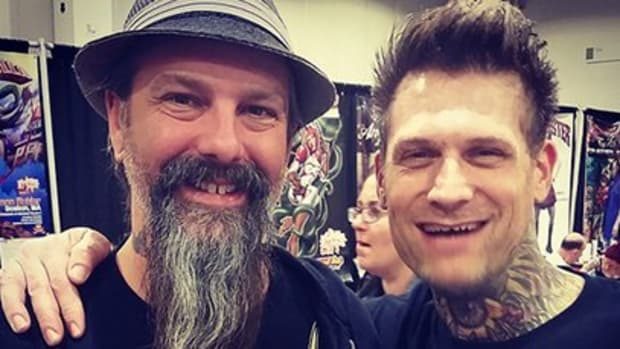 Tattoo artist Kyle Dunbar poses with Villain Arts head Troy Timpel.