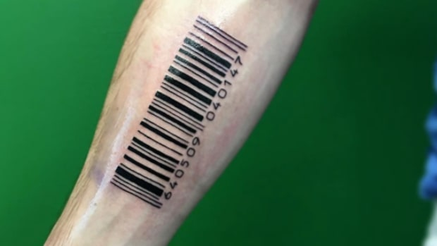 big barcode tattoo on forearm