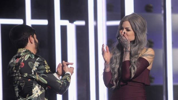 """NEW YORK, NY - DECEMBER 06:  Season 8 winner of """"Ink Master"""" Ryan Ashley and season 8 finalist Gian Karle react onstage during """"Ink Master"""" Season 8 Live Finale at at Manhattan Center Grand Ballroom on December 6, 2016 in New York City.  (Photo by Brad Barket/Getty Images for Spike) *** Local Caption *** Ryan Ashley; Gian Karle"""