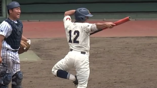 Baseball player pointing his bat