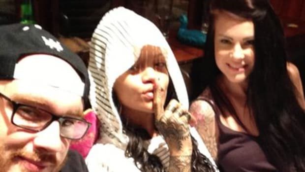 Rihanna (center) shows off her new hand tattoo with tattoo artists Bang Bang and Cally-Jo.