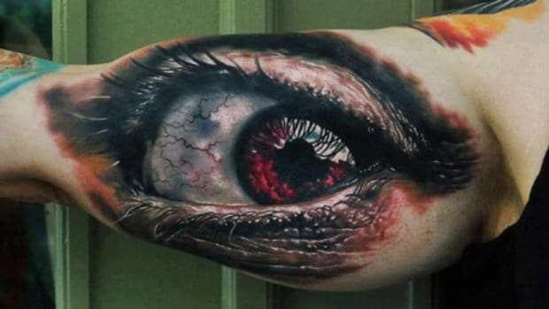 Giant realistic red eye tattoo by Den Yakovlev (TN)
