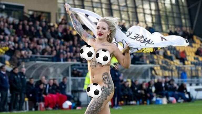Tattooed Stripper Streaks During Dutch Soccer Game