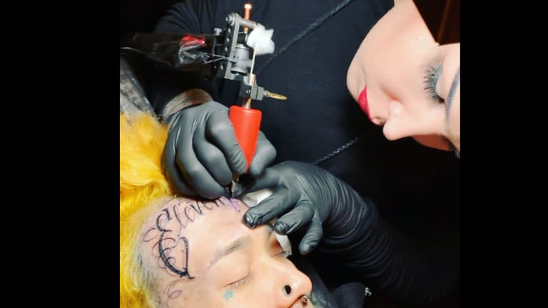 Watch Kat Von D Give a Forehead Tattoo