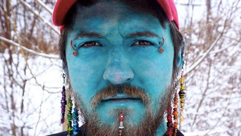 This 26-Year-Old is Self-Tattooing His Entire Body Blue