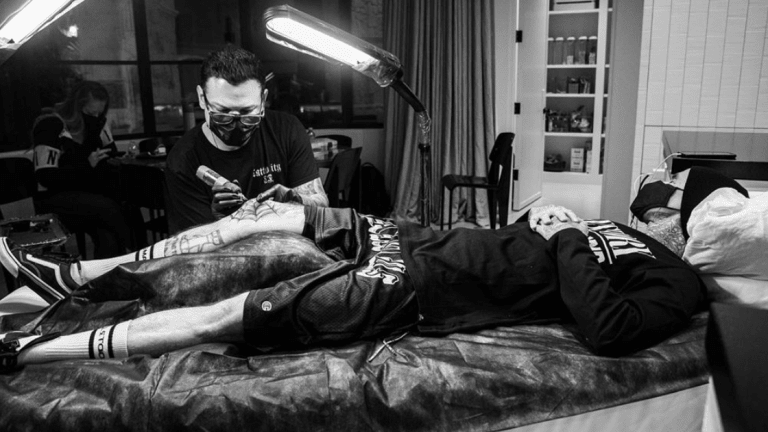 Travis Barker Adds a Spiderweb Tattoo to His Collection
