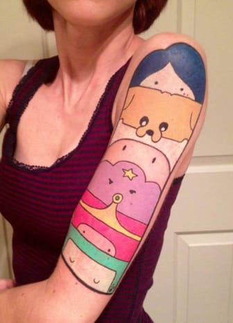 This sleeve incorporating most of the characters from the show is one of our favorite tattoos ever. So cool!