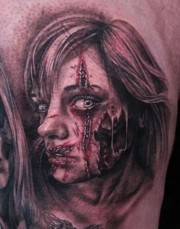 This gruesome tattoo was done by Stefano Alcantara.