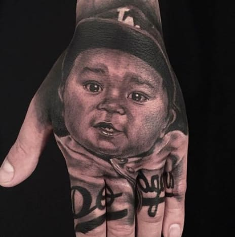 This cute lil' Dodger fan was inked by Anam Q.