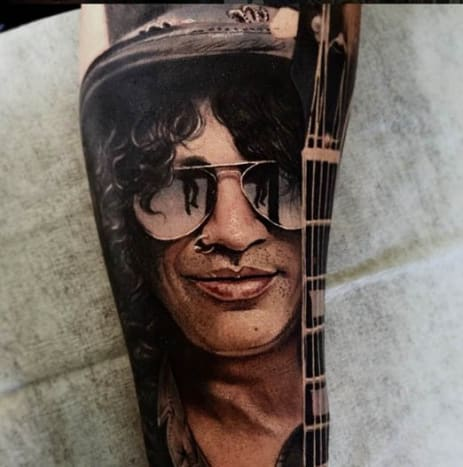 Getting a portrait tattoo like this one of Slash from Guns N Roses requires a little bit of patience. See what we did there, eh?