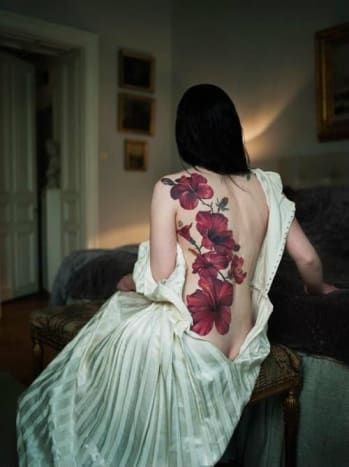 This beautiful full back tattoo contrasts nicely with the bride's dress.