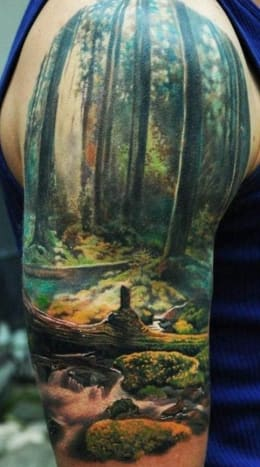 Den Yakovlev inked this gorgeous tattoo of an old growth forest.