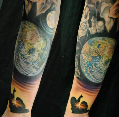This beautiful tribute to Earth was tattooed by Megan Jean Morris.