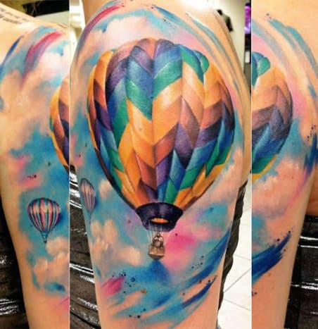 The bright colors used in this hot air balloon make it hard to believe that it is a tattoo and not a photo.