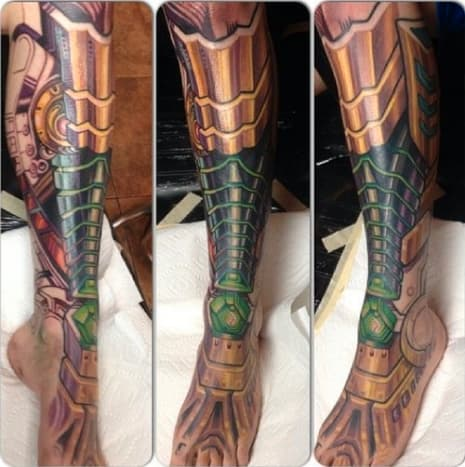 This amazing robot leg tattoo was done by Mike Cole.