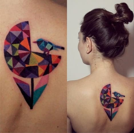 The way the colors are used in this tattoo almost look as if it were a piece of stained glass.