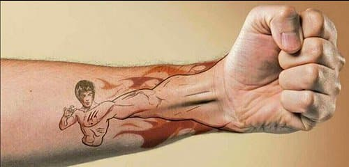 We really, really want someone to actually get this Bruce Lee tattoo.