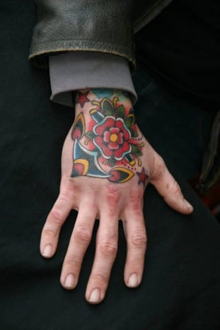 Traditional Anchor with Flower  Hand Tattoo by Marcus Kuhn