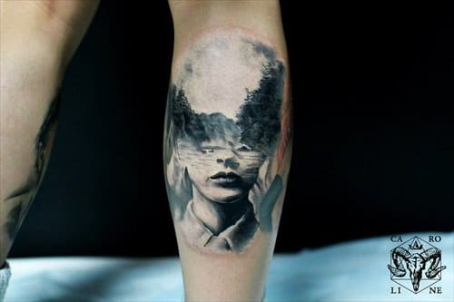 Friedmann specializes in surreal images incorporating the outlines of faces, like this amazing tattoo here.