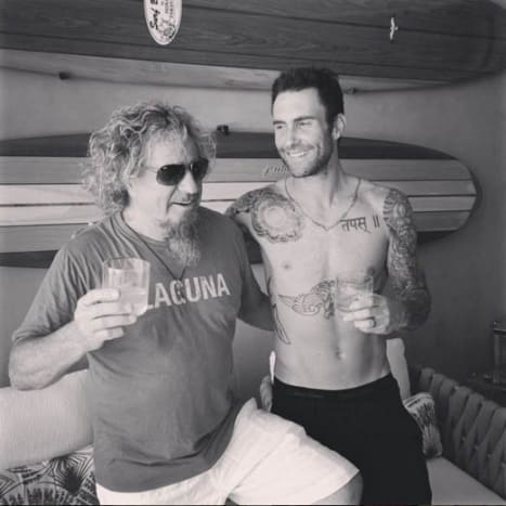 Adam hanging out with Sammy Hagar before he added the three new tattoos.
