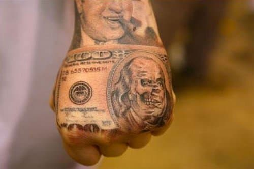 This amazing zombie Ben Franklin 100 Dollar tattoo was done by Jose Lopez.