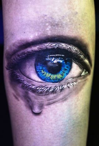 If an actual tear came out of this tattoo we would not be surprised.