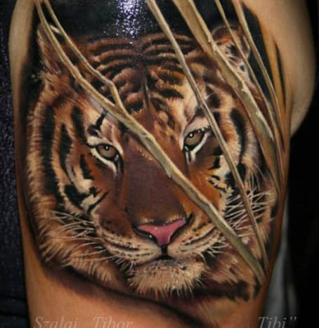This tattoo gives us shivers... we're afraid that hungry lion is about to pounce.