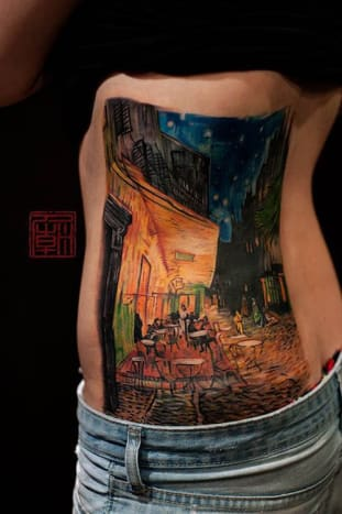 This tattoo by Wang is an almost perfect rendition of Vincent Van Gogh's Cafe Terrace at Night.