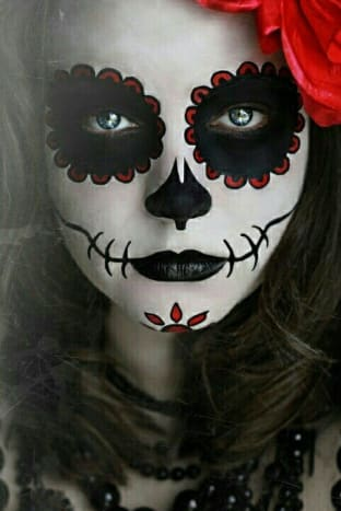 Black and red sugar skull makeup, in celebration of Día de los Muertos (Day of the Dead).