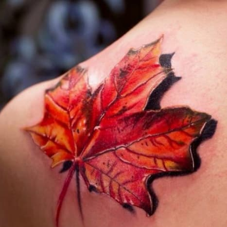 This 3D maple leaf looks like it could blow off of this person's arm at any moment.