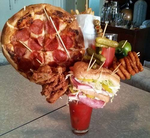 Comedian Randy Liedtke created this monster of a Bloody Mary replete with a pizza, a footlong sub, fried chicken and a sandwich. Oh yeah and with another Bloody Mary.