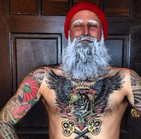 Painter Tyson McAdoo dressed up as a tattooed Santa Claus