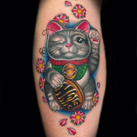 This adorable Lucky Cat (Maneki-neko in Japanese) was tattooed by Megan Massacre.