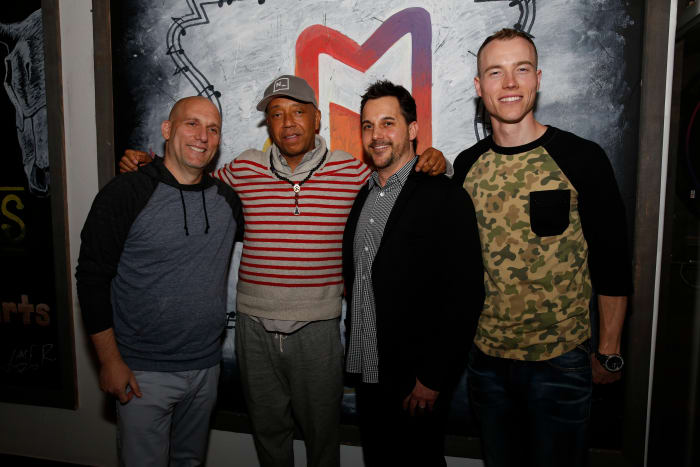 AUSTIN, TX - MARCH 11: (L-R) CEO ADD Management Steve Rifkind, Founder All Def Music Russell Simmons, Chief Marketing Officer of Samsung Telecommunications America, Todd Pendleton and DJ Skee attend the All Def Digital (ADD) and All Def Music with Samsung launch of ADD52 at SXSW on March 11, 2014 in Austin, Texas. (Photo by Rick Kern/Getty Images for Samsung)