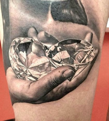 This hand full of bling was inked by Matteo Pasqualin.