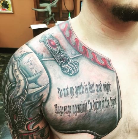 "Prince Jackson's new tattoos, which took a total of 12 hours spaced out over the course of two days, include a fierce half-sleeve design featuring a dragon's head, and an armor-inspired chest piece that contains an excerpt from the famous poem, ""Do Not Go Gentle into that Good Night,"" written by the late Welsh poet Dylan Thomas. The poem reads, ""Do not go gentle into that good night. Rage, rage against the dying of the light,"" but in Jackson's chest tattoo, the first line reads, ""Do not go gentle in that good night,"" and in the second line, the word ""against"" appears to be misspelled as ""agenainst."""
