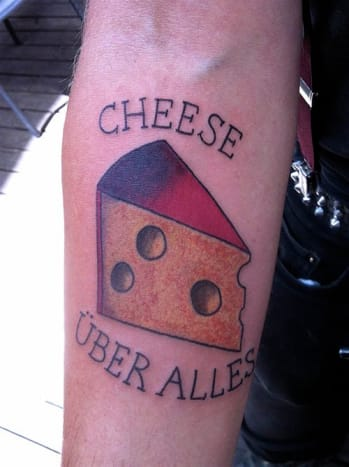Cheese above all! This cool tattoo was inked byZoe Bean.