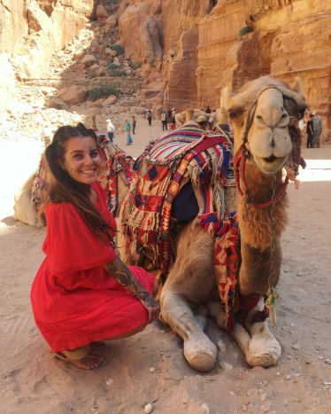 Photo via the tattooed travelerMaking camel friends while exploring the Lost City of Petra, Jordan.
