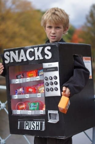This kid clearly doesn't understand that the point of Halloween is to obtain candy, not sell it.