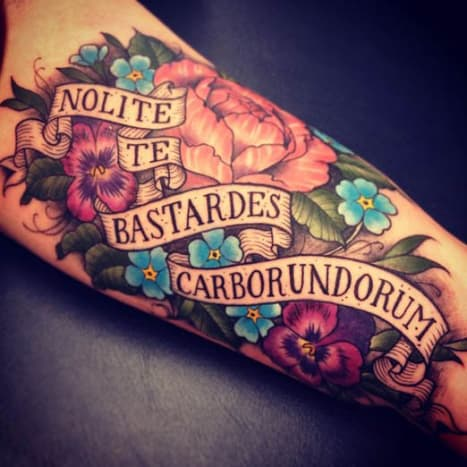 """This beautiful ink translates to """"Don't let the bastards grind you down."""" Which happens to be one of our favorite ska songs!"""