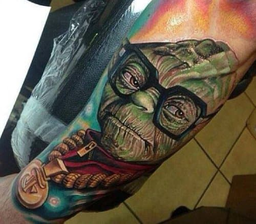 Roman Abrego inked this tattoo of Yoda as a huge Run DMC fan.