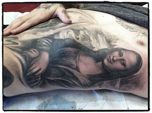 This black and grey rendition of the Mona Lisa was tattooed by Kat Von D.