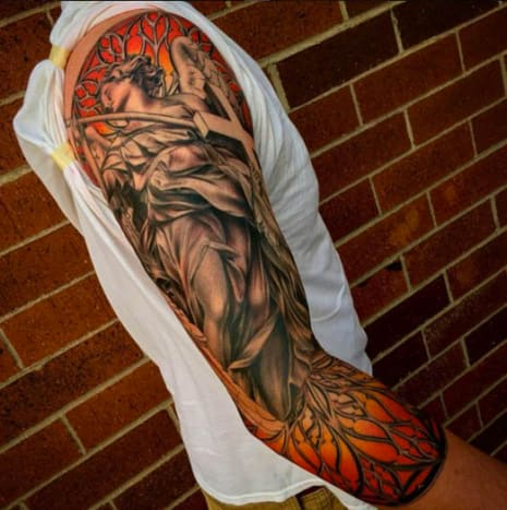 The colors in the background of this religiously themed sleeve makes all of the other elements pop.