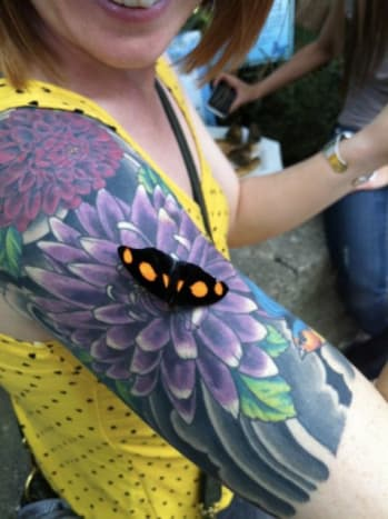 This flower tattoo looks so realistic it confused this poor butterfly!