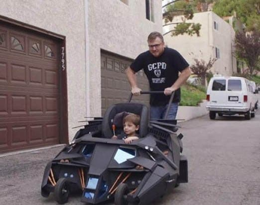 Batman has Robin, and this little guy has his dad to help him fight crime and keep the Batmobile moving!