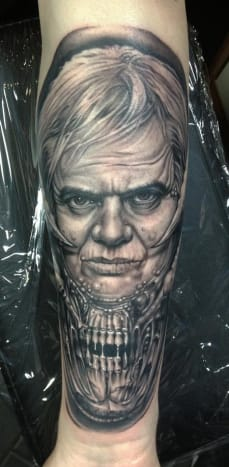 Bob Tyrrell incorporated Giger's most famous work, the alien from Aliens, in this portrait of the surrealist.