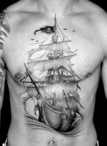 Yarrrrrrrr! This is an amazing tattoo of a pirate ship.