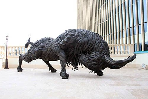 Beware this charging buffalo, you know that he'll get good traction with tires for feet.