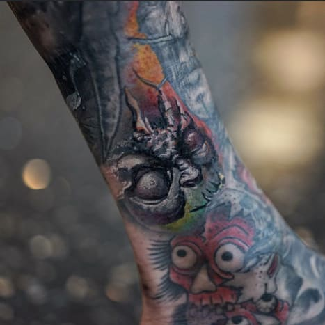 This fantastic little tattoo was done by Dmitry VisiononFreshly Inked contributor and tattoo collectorYallzee.