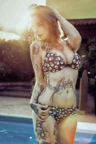 Inked Girl Riae Suicide goes for a dip.